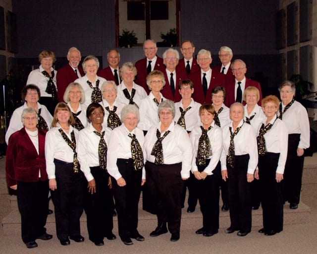 """The """"Young At Heart Singers"""" are a 26-voice chorus of retired men and women based in East Lansing, Michigan who love to share their message of faith and hope through song."""